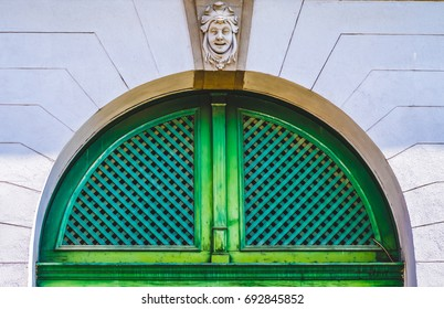 Old green circular door with sculpture above it in Sibiu, Romania