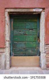 Old green door in brick wall