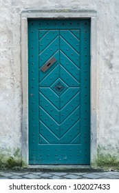 Old green door with letter slot