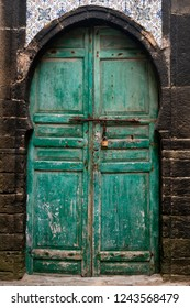 Old green door with traditional portal in Essaouira, Morocco