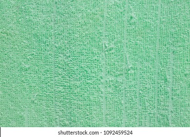 Old green fabric of towel for background and texture.