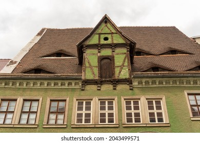 old green facade in the city