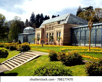 Old green house in beautiful formal garden. in public park with spring flowers in Stuttgart, Germany in Europe