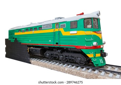 the old green locomotive on a white background