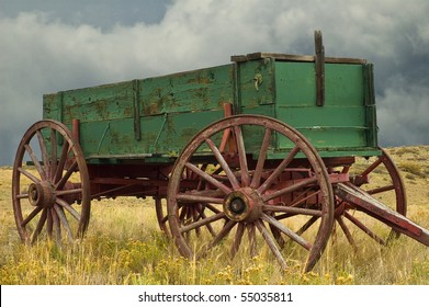 Old Green and REd Buckboard Wagon on Prairie in Colorado