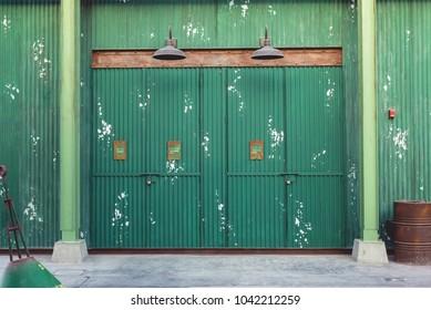 Old green rustic doors background
