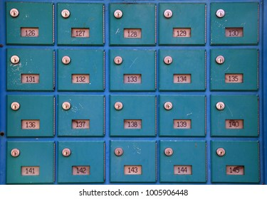 Old green vintage post boxes with numbers, mailbox pattern, group of old letterbox with lock