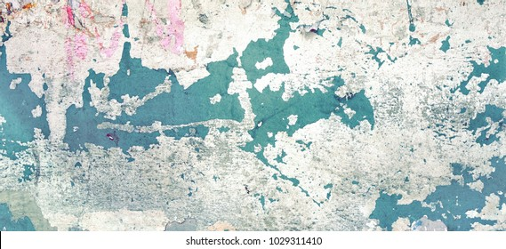 Old Green White Distressed Brick Wall With Graffiti  Art. Rough Wide Background Or Grunge Texture. Shabby Vintage Concrete Wall With Painted Surface. Abstract Web Banner. Shabby Design Element