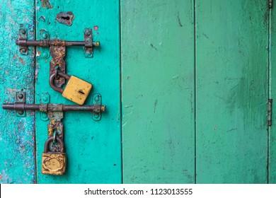 old green wooden door rusty metal key lock vintage texture background