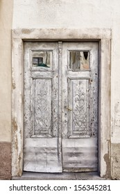 Old grey double doors
