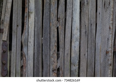 Old grey wooden fence in village