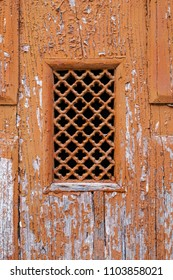 old grid on stained door