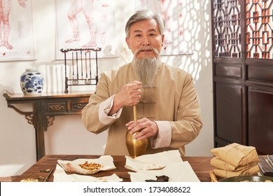 The old grinding of Chinese herbal medicine of traditional Chinese medicine - Shutterstock ID 1734088622