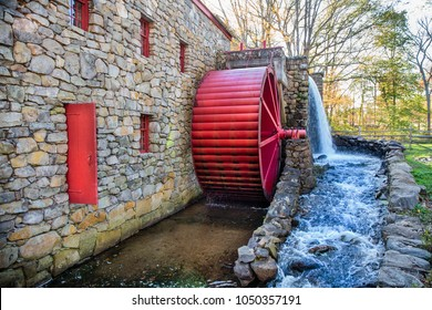 old grist mill. working water mill with a red wheel. Old stone grist mill in Sudbury, MA