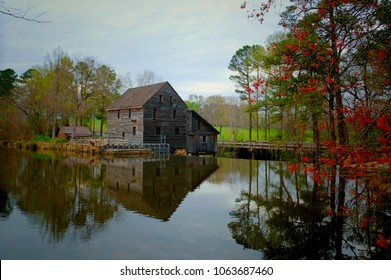 The old gristmill or watermill across the millpond during spring at Yates Mill County Park in Raleigh North Carolina, Triangle area, Wake County.