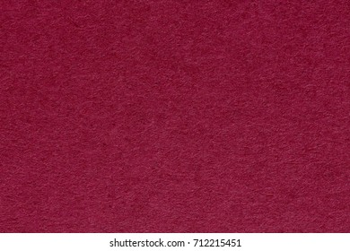 Old, grunge background texture in red. High resolution photo.