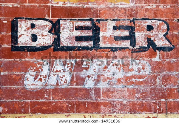 """Old grunge brick wall with inscription """"BEER ON TAP"""""""