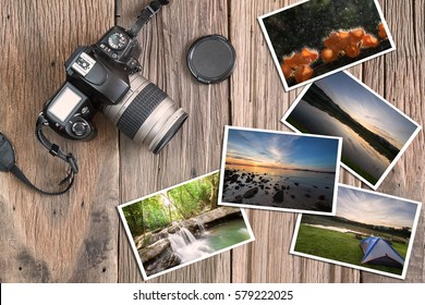 Old grunge camera and photos on vintage grunge wooden background in vintage style
