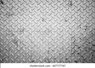 Old grunge checkered steel plates background - Black and White