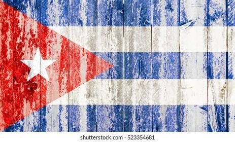old grunge cuban flag on broken crack wood with rift, havana cuba communist dictatorship, pray for president concept