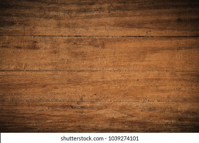 Old grunge dark textured wooden background,The surface of the old brown wood texture,top view brown teak wood paneling