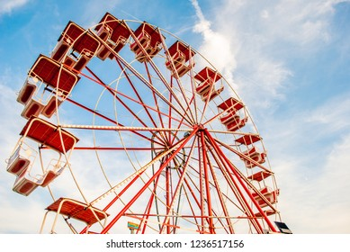 Old grunge ferris wheel against blue spring sky