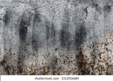 Old grunge metal texture uneven surface.Aged rust background of damaged door fortress. Oxide stain steel hard plaque. Grunge vintage wall corroded. Retro corrosive dirty dark iron frame for 3D pattern