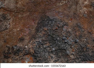 Old grunge metal texture uneven surface. Aged rust background of damaged door fortress. Copper oxide stain steel hard brass plaque. Vintage corroded tank. Retro corrosive dirty dark iron sheet pattern