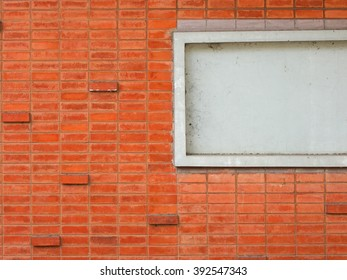 Old grunge orange brick wall. Packed with fiber spider in the window, background texture