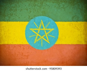 old grunge paper with Ethiopia flag background