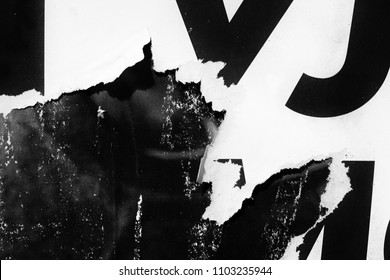 Old grunge ripped torn vintage collage posters creased crumpled paper surface texture background plackard