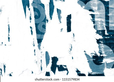 Old grunge ripped torn vintage collage posters creased crumpled paper surface texture background blue