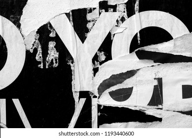 Old grunge ripped torn vintage collage posters creased crumpled paper surface texture background backdrop placard