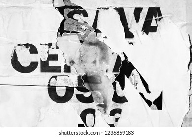 Old grunge ripped torn vintage collage posters creased crumpled paper surface texture background backdrop placard black white