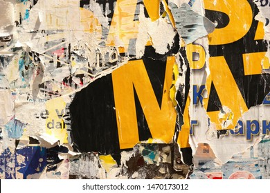 Old grunge ripped torn vintage collage street blank posters crumpled paper surface placard texture background backdrop