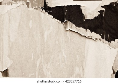 Old grunge ripped torn vintage collage posters and creased crumpled paper surface texture background