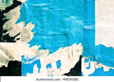 Old grunge ripped torn vintage collage street posters / Creased crumpled paper surface texture background