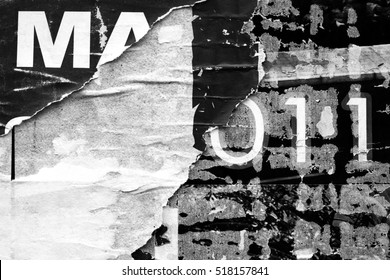 Old grunge ripped torn vintage collage street posters creased crumpled paper surface texture background