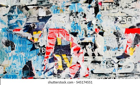 Old grunge ripped torn vintage collage street urban posters creased crumpled paper surface texture background