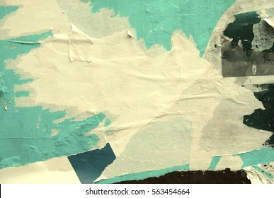 Old grunge ripped torn vintage collage posters creased crumpled paper surface texture background backdrop space for text