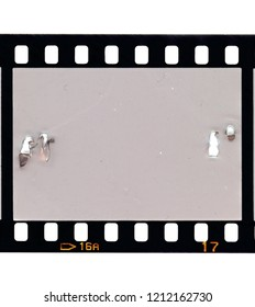 Old grunge scratched 35mm film strip frame. Design element on white. Just blend in your own picture to make it look used or retro