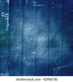 Old grunge scratched texture, dark blue background.