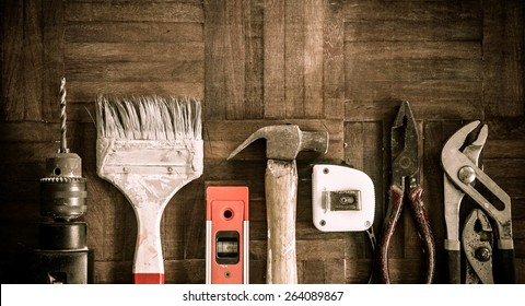 old & grunge set of hand tools on wood floor for home renovation background