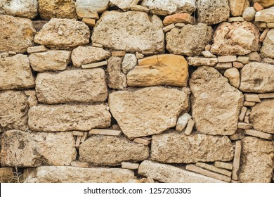 Old grunge stone background. Horizontal color photography.