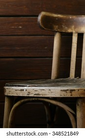 Old grunge vintage chair on a wooden background