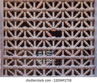 Old grunge weathered wooden fixed latticed window (Mashrabiya), Cairo, Egypt