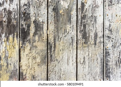 Old grunge wood with peeling paint.