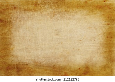 Old grunge wooden kitchen cutting board as background