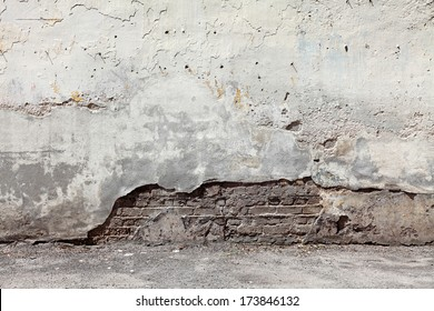 Old grungy cement brick wall with blank space for text.