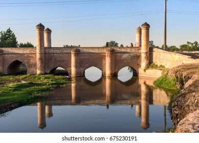 Old grungy mughal style bridge over a canal in peshawar city